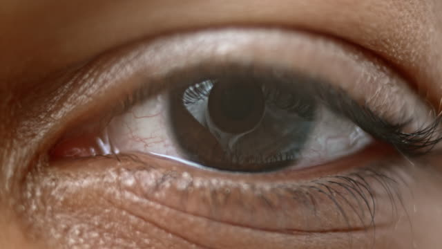 ECU Brown colored iris of a human eye Extreme close up shot of a brown colored iris of a person of an African-American ethnicity. eye stock videos & royalty-free footage