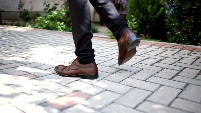 Brown shoes on male legs Brown shoes on male legs human foot stock videos & royalty-free footage