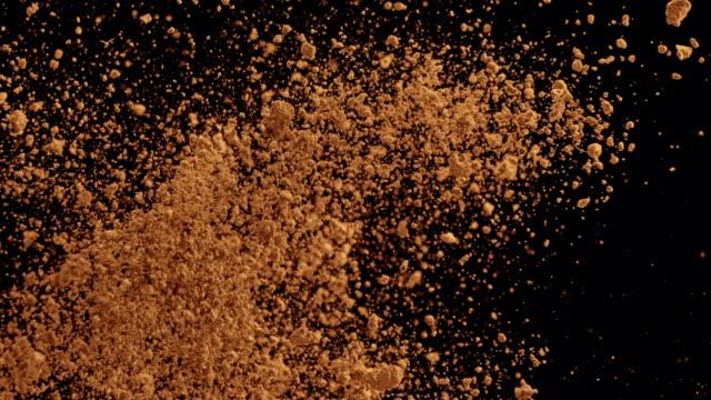 SLO MO Brown sugar collision on black background video