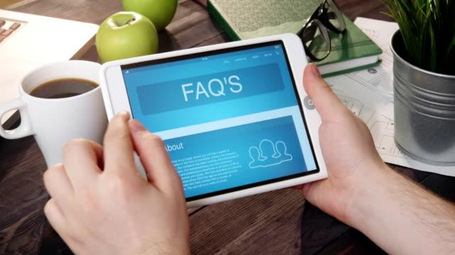 vídeos y material grabado en eventos de stock de navegación faq de uso de tablet pc - faq