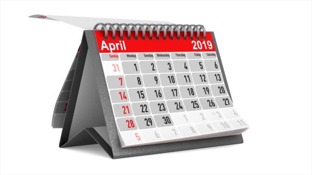 vídeos de stock, filmes e b-roll de browsing do calendário do desktop no fundo branco. 3d isolado rendem. 2019 ano - calendário