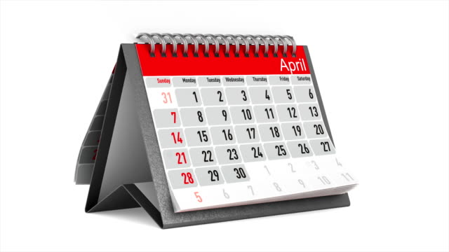 Browsing of the desktop calendar on white background. Isolated 3D render video