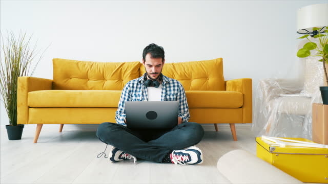 Browsing online for interior design ideas.
