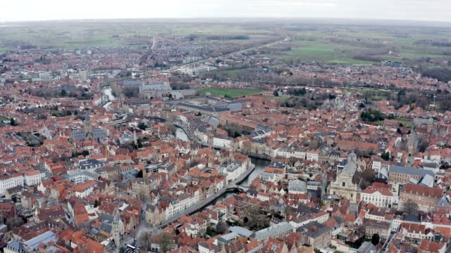 bruges urban aerial view in belgium - bruges video stock e b–roll