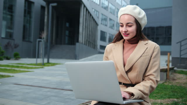 Brunette business woman laptop outside in beautiful style on business center