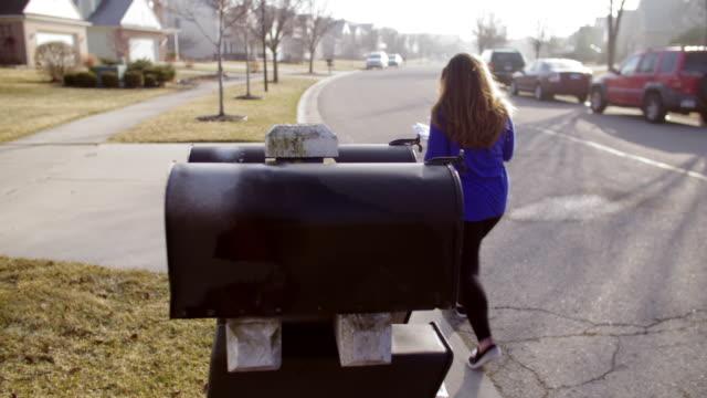 Brunette checks mailbox in Mid West suburb video