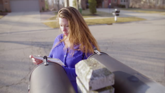 Brunette collects morning mail in Mid West suburb video