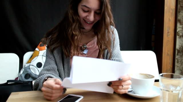 Brunette girl reading a letter video