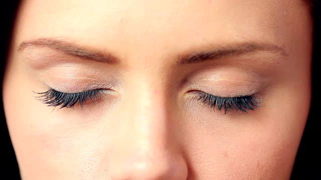 Brunette opening her blue eyes video