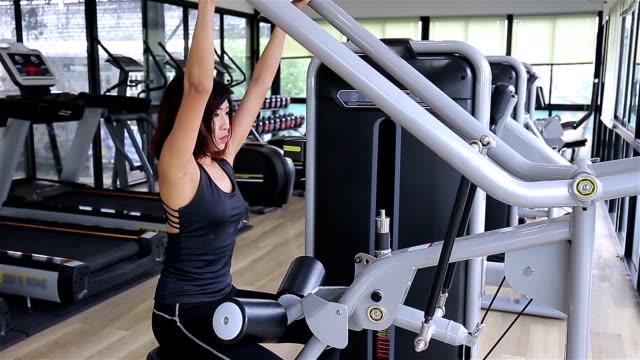 Brunette woman doing chest exercise video