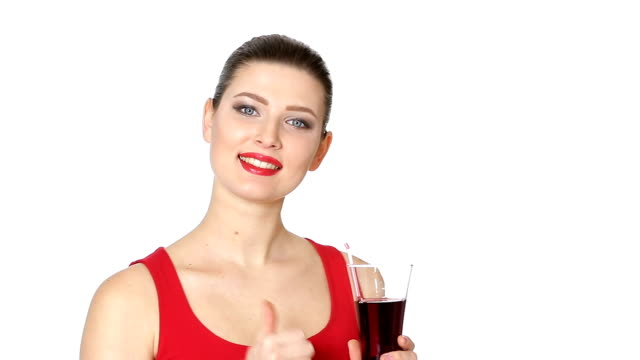 brunette woman drinking cherry juice from glass video