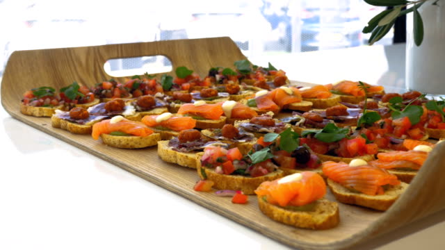 Bruschetta of Various Flavors on a Tray Atop a Table video
