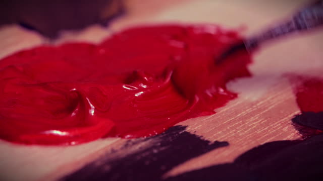 brush brushwork red paint wooden surface