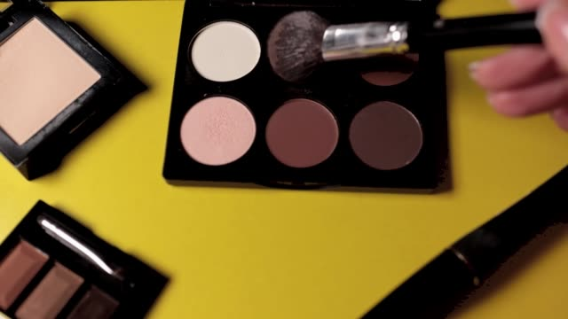 Brush collect color face shadows for make-up on yellow background. Brush collect color face shadows for make-up on yellow background.Makeup brush, tone, face, beauty, hide, contouring, professional, beauty, visage foundation make up stock videos & royalty-free footage