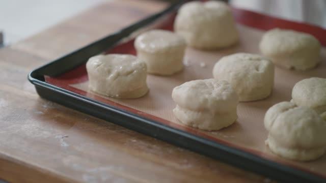 brush egg on the scone for baking - scone filmów i materiałów b-roll