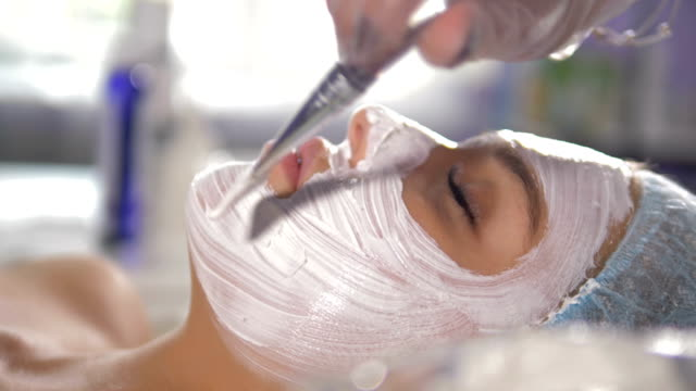 a brush leaves thick strokes with facial mask. - face mask stock videos & royalty-free footage