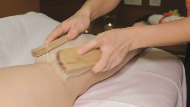 Brush Massage on womans leg, closeup video