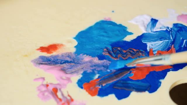 Brush mix paints on palette video