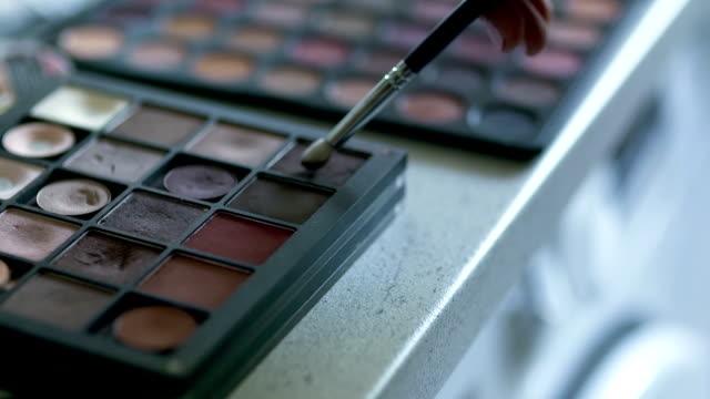 Brush set for make-up on table Close up of Brush set for make-up on table. Make up artist equipment. eyeshadow stock videos & royalty-free footage