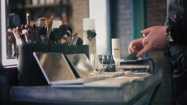 Brush sets and shadow palettes for make-up on the table in beauty salon video