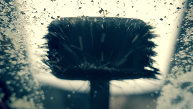 Brush vacuum cleaner sucks up dust and garbage.  Slow mo, slo mo video