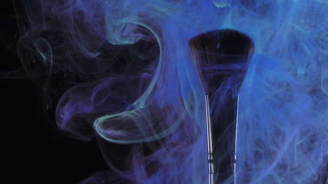 Brush with blue color smoke on black background 4k Make up brush painting with beautiful color smoke on black background painting art product stock videos & royalty-free footage