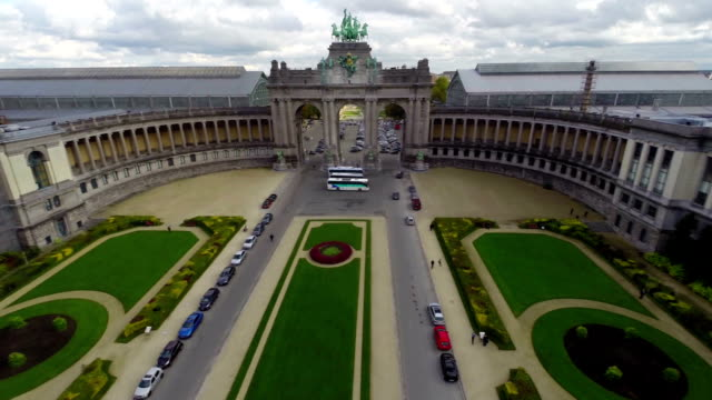 Brussels aerial in Park above Arc with horses, city view. Beautiful aerial shot above Europe, culture and landscapes, camera pan dolly in the air. Drone flying above European land. Traveling sightseeing, tourist views of Belgium. video