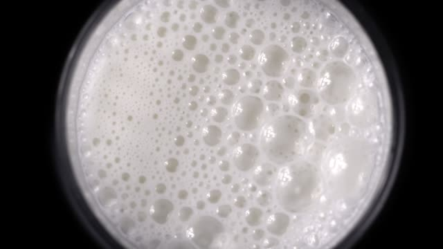 Bubble milk on black background. Top View video