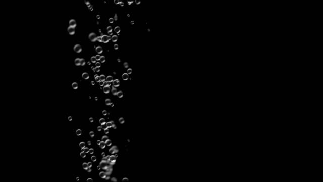 Bubble surges on black background move upwards. Seamless loop video
