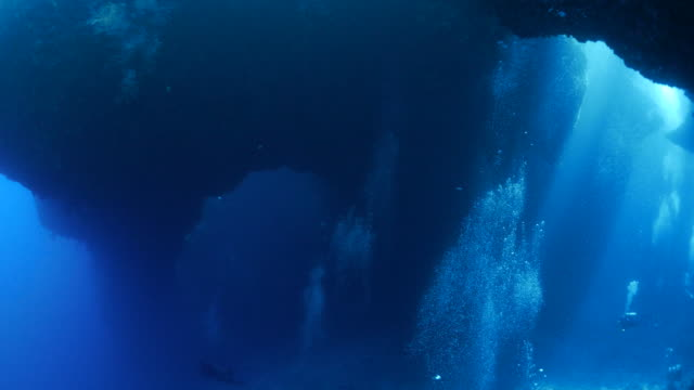 Bubbles from a crowd of divers filled all the cave Underwater, Palau - May 22, 2017 : Scuba diving undersea (2017_0520_0531-0522_1018_B) cave stock videos & royalty-free footage