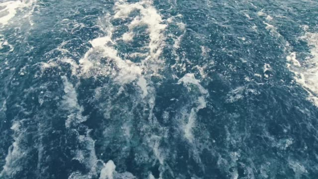bubbling water from a yacht, view of the waves in the sea from a yacht bubbling water from a yacht, view of the waves in the sea from a yacht 4k yachting stock videos & royalty-free footage
