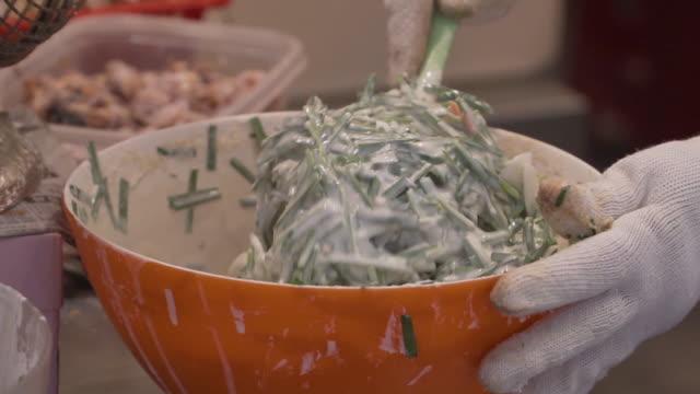 buchimgae / bindaeddeok, korean traditional pancake - crucifere brassicali video stock e b–roll