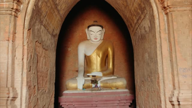 Buddha Figure inside Ancient Temple Push-in shot of statue inside of a temple in Old Bagan, Myanmar bagan stock videos & royalty-free footage