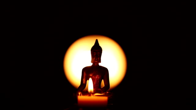 Buddha statue and candles video