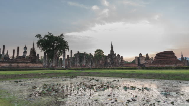 Buddha Statue at Wat Mahathat in Sukhothai Historical Park 4K Time-lapse: Buddha Statue at Wat Mahathat in Sukhothai Historical Park in the evening before sunset - Stock video lotus position stock videos & royalty-free footage