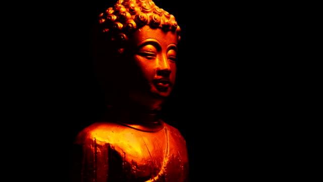 buddha staty i fire glow - india statue bildbanksvideor och videomaterial från bakom kulisserna
