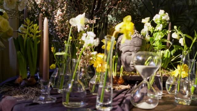 buddha statue in flowers