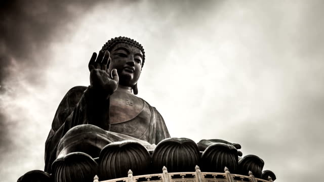Buddha Time Lapse in Hong Kong A time lapse of a Buddha statue against the sky. Shot on Lantau island in Hong Kong.  buddha stock videos & royalty-free footage