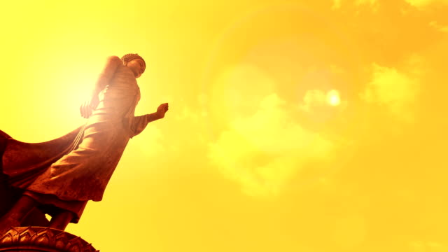 Buddha timelapse with sun flare video