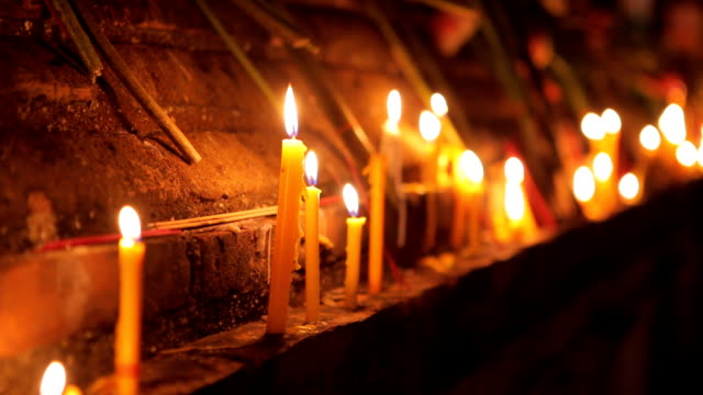 Buddhism lighted candles trail around ancient temple video