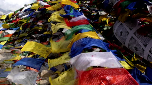 Buddhist colorful prayer flags blow by the wind in the mountains in Himalayas, India. video