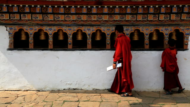 EDITORIAL : Buddhist monk in bhutan and the prayer wheels video