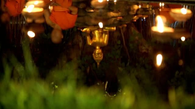 Buddhist Monk Meditation at Night with Buddha statue video