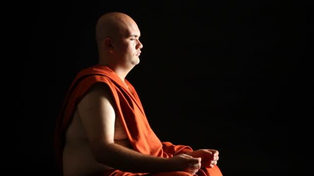 Buddhist monk praying video