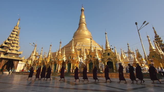 Buddhist Monks Walking Around Shwedagon Pagoda in Yangon, Myanmar (Burma) video