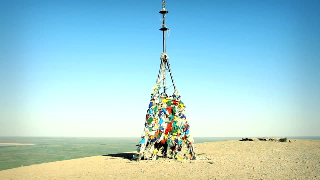Buddhist obo on the hill by lake Baskunchak. Russia video