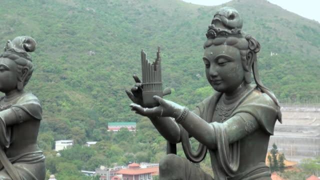 Buddhistic Statues praising in Lantau Island, in Hong Kong