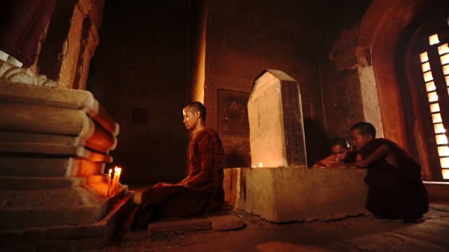 Buddist Monk make merrit and Meditation in ancient temple Buddhist Monk make merit and Meditation in ancient temple at Bagan, Myanmar buddhism stock videos & royalty-free footage