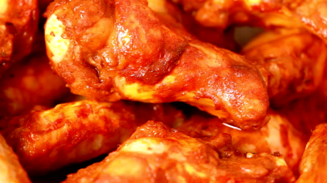 Buffalo wings Close up spicy chicken wings with barbecue sauce in basket dipping sauce stock videos & royalty-free footage