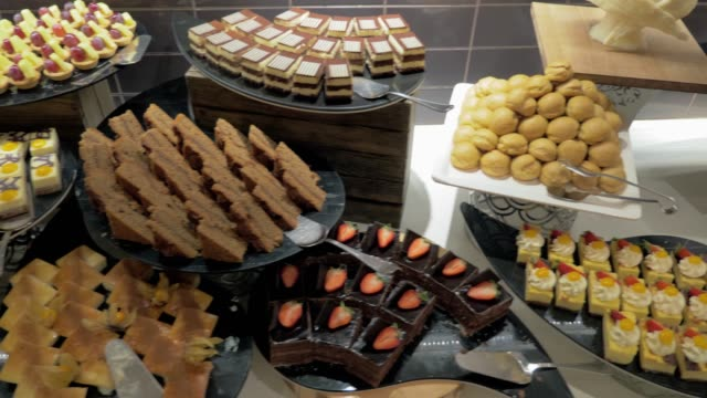 buffet table with desserts in hotel - buffet video stock e b–roll